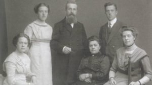 Corrie ten Boom (standing) with her family