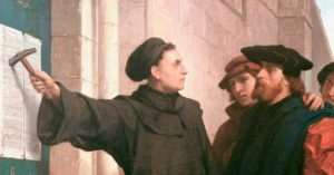 Artist's depiction of Martin Luther nailing his 95 Theses to the Wittenberg church door