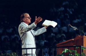 Billy Graham preaching in mid life